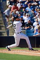 New York Yankees shortstop Troy Tulowitzki (12) follows through on a swing during a Grapefruit League Spring Training game against the Toronto Blue Jays on February 25, 2019 at George M. Steinbrenner Field in Tampa, Florida.  Yankees defeated the Blue Jays 3-0.  (Mike Janes/Four Seam Images)