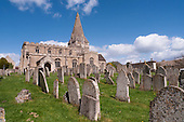 Kings Cliffe, Northamptonshire. Church of All Saints and St James and grave stones.