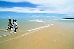 Tiwi youths on the beaches of Bathurst Island, Australia