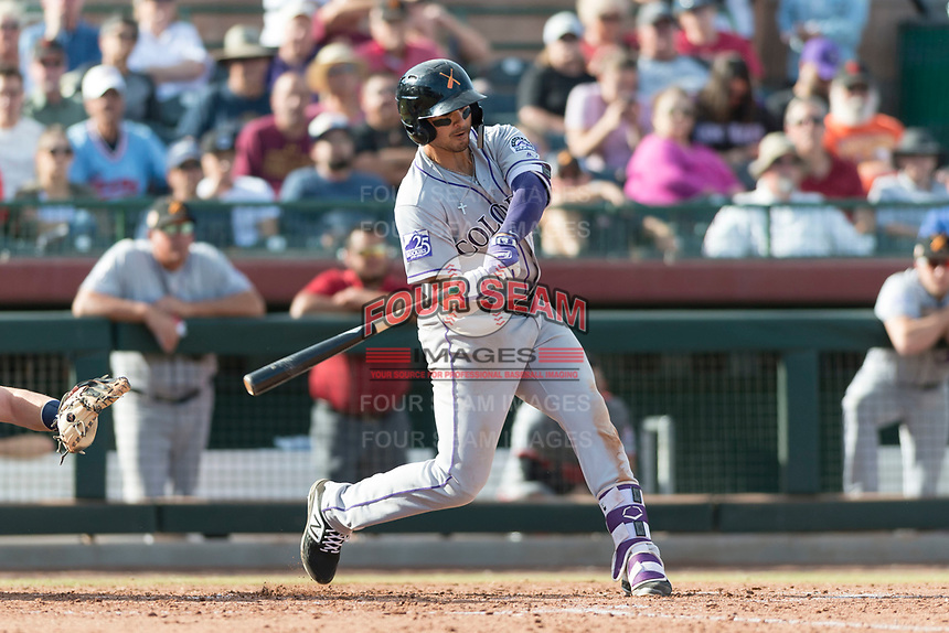 Salt River Rafters third baseman Josh Fuentes (19), of the Colorado Rockies organization, swings at a pitch during the Arizona Fall League Championship Game against the Peoria Javelinas at Scottsdale Stadium on November 17, 2018 in Scottsdale, Arizona. Peoria defeated Salt River 3-2 in 10 innings. (Zachary Lucy/Four Seam Images)