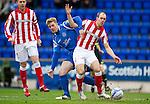 St Johnstone v Rangers....05.04.11 .Steven Whittaker under pressure from Jordan Robertson.Picture by Graeme Hart..Copyright Perthshire Picture Agency.Tel: 01738 623350  Mobile: 07990 594431