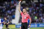 Referee Alfonso Alvarez Izquierdo shows a yellow card during their La Liga match between Deportivo Leganes and Real Madrid at the Estadio Municipal Butarque on 05 April 2017 in Madrid, Spain. Photo by Diego Gonzalez Souto / Power Sport Images