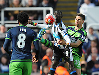 Federico Fernandez of Swansea City (right) grapple with Papiss Cisse of Newcastle United (centre) during the Barclays Premier League match between Newcastle United and Swansea City played at St. James' Park, Newcastle upon Tyne, on the 16th April 2016