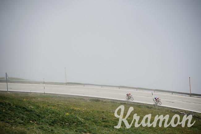 Dutch Champion Dylan Groenewegen (NLD/LottoNL-Jumbo) & Yukiya Arashiro (JAP/Lampre-Merida)  descending in the mist from the highest point in the 2016 Tour; the Port d'Envalira (Cat1/2408m/22.6km at 5.5%)<br /> <br /> stage 10: Escaldes-Engordany (AND) - Revel (FR)<br /> 103rd Tour de France 2016