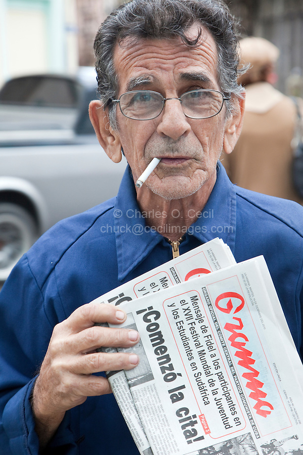 Cuba, Havana.  Street Vendor Selling Granma, the Official Communist Party Newspaper.