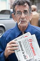 Cuba, Havana.  Street Vendor Selling Granma, the Official Communist Party Newspaper.