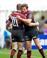 20120823 Copyright onEdition 2012©.Free for editorial use image, please credit: onEdition..Alex Goode of Saracens (right) congratulates Chris Ashton of Saracens after he runs in a hat trick of tries at The Honourable Artillery Company, London in the pre-season friendly between Saracens and Stade Francais Paris...For press contacts contact: Sam Feasey at brandRapport on M: +44 (0)7717 757114 E: SFeasey@brand-rapport.com..If you require a higher resolution image or you have any other onEdition photographic enquiries, please contact onEdition on 0845 900 2 900 or email info@onEdition.com.This image is copyright the onEdition 2012©..This image has been supplied by onEdition and must be credited onEdition. The author is asserting his full Moral rights in relation to the publication of this image. Rights for onward transmission of any image or file is not granted or implied. Changing or deleting Copyright information is illegal as specified in the Copyright, Design and Patents Act 1988. If you are in any way unsure of your right to publish this image please contact onEdition on 0845 900 2 900 or email info@onEdition.com