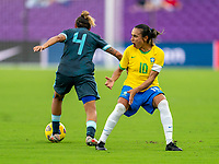 ORLANDO, FL - FEBRUARY 18: Marina Delgado #4 of Argentina gets past Marta #10 of Brazil during a game between Argentina and Brazil at Exploria Stadium on February 18, 2021 in Orlando, Florida.