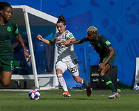 GRENOBLE, FRANCE - JUNE 22: Lina Magull #20 of the German National Team dribbles at midfield as Uchenna Kanu #12 of the Nigerian National Team defends during a game between Panama and Guyana at Stade des Alpes on June 22, 2019 in Grenoble, France.