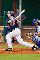 Travis Harrison #17 of the Elizabethton Twins follows through on his swing against the Bluefield Blue Jays at Joe O'Brien Field on July 14, 2012 in Elizabethton, Tennessee.  The Twins defeated the Blue Jays 4-0.  (Brian Westerholt/Four Seam Images)