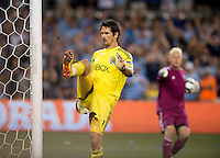 Michael Gspurning (1) of the Seattle Sounders kicks the post in frustration after having the referee say he came off his line during a penalty kick during the game at Livestrong Sporting Park in Kansas City, Kansas.   Sporting Kansas City won the Lamar Hunt U.S. Open Cup on penalty kicks after tying the Seattle Sounders in overtime.