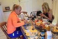 England, London, June 30, 2015, Tennis, Wimbledon, Richel Hogenkamp (NED) checking her messages during breakfast<br /> Photo: Tennisimages/Henk Koster