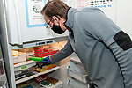 University of Rhode Island Research Assistant Professor, T.J. McGreevy, Jr., extracts mitochondrial DNA samples taken out of cheek swabs from New England cottontail rabbits trapped in Rhode Island.  He is taking the DNA extracted samples and placing them in a refrigerator to presevre the integrity of the samples for further analysis.