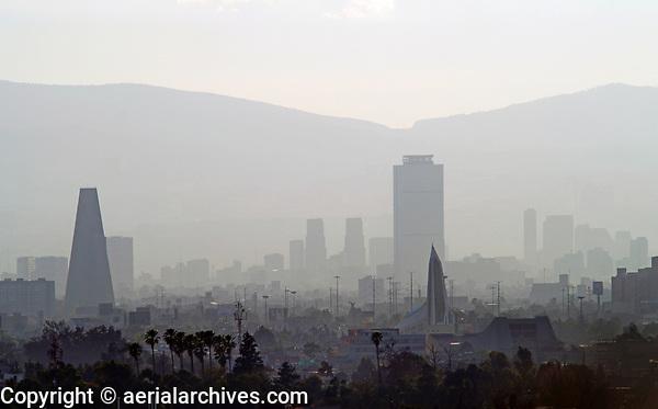 aerial photograph of smog and air pollution in Mexico City with a skyline view that includes  the PEMEX tower in the center and Banobras tower at the left | fotografía aérea de smog y contaminación del aire en la Ciudad de México con una vista del horizonte que incluye la torre de PEMEX  y la torre de Banobrasa