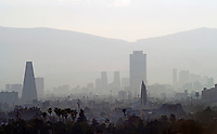 aerial photograph of smog and air pollution in Mexico City with a skyline view that includes  the PEMEX tower in the center and Banobras tower at the left | fotografía aérea de smog y contaminación del aire en la Ciudad de México con una vista del horizonte que incluye la torre de PEMEX  y la torre de Banobrasa