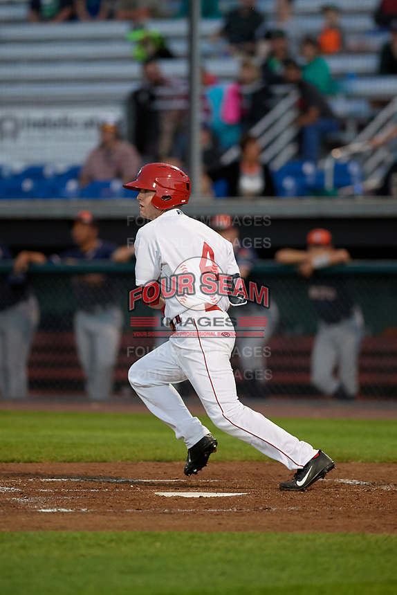 Auburn Doubledays left fielder Nick Choruby (4) follows through on a swing during a game against the Connecticut Tigers on August 8, 2017 at Falcon Park in Auburn, New York.  Auburn defeated Connecticut 7-4.  (Mike Janes/Four Seam Images)