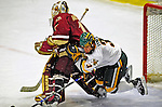 9 January 2009: University of Vermont Catamounts' forward Peter Lenes, a Senior from Shelburne, VT, takes a tumble behind the opposing goaltender during the first game of a weekend series against the Boston College Eagles at Gutterson Fieldhouse in Burlington, Vermont. The Catamounts scored with one second remaining in regulation time to earn a 3-3 tie with the visiting Eagles. Mandatory Photo Credit: Ed Wolfstein Photo
