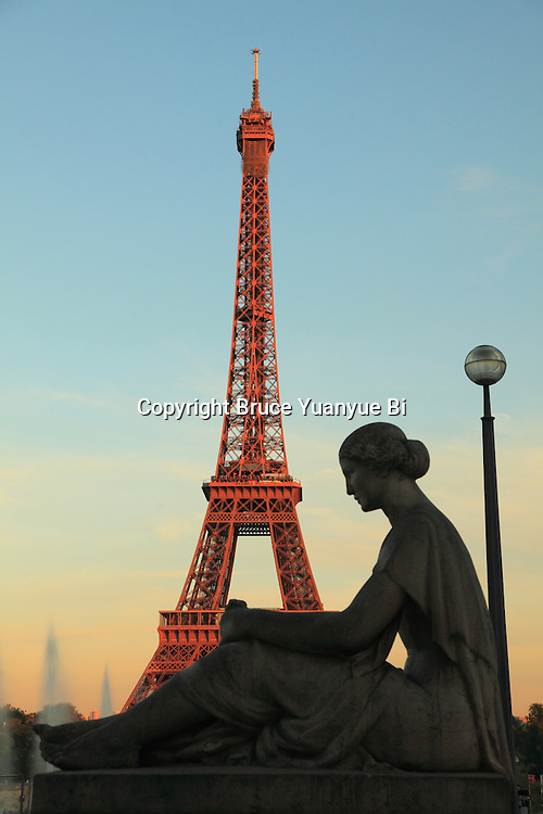 Statue in Palais de Chaillot with Eiffel Tower in the background. City of Paris. Paris. France