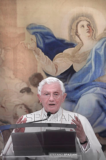 Pope Benedict XVI blesses pilgrims during his Angelus prayer ahead of a mass to mark the Assumption Day, honoring the Virgin Mary in the church of his summer residence in Castel Gandolfo, in the outskirts of Rome, on August 15, 2012