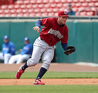 Lehigh Valley IronPigs first baseman Cody Overbeck #10 fields a ground ball during a game against the Buffalo Bisons at Coca-Cola Field on April 19, 2012 in Buffalo, New York.  Lehigh Valley defeated Buffalo 8-4.  (Mike Janes/Four Seam Images)