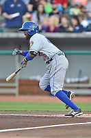 Chattanooga Lookouts catcher Carlos Paulino (46) swings at a pitch during a game against the Tennessee Smokies on April 25, 2015 in Kodak, Tennessee. The Smokies defeated the Lookouts 16-10. (Tony Farlow/Four Seam Images)