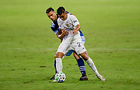 CARSON, CA - OCTOBER 18: Ali Adnan #53 of the Vancouver Whitecaps battles with Efrain Alvarez #26 of the Los Angeles Galaxy for a ball during a game between Vancouver Whitecaps and Los Angeles Galaxy at Dignity Heath Sports Park on October 18, 2020 in Carson, California.