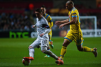 Swansea, UK. Thursday 20 February 2014<br /> Pictured: Pablo Hernandez is chased down by Gokhan Inler of Napoli<br /> Re: UEFA Europa League, Swansea City FC v SSC Napoli at the Liberty Stadium, south Wales, UK