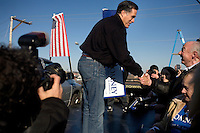 """Republican presidential candidate Mitt Romney, former governor of Massachusetts, greets supporters and signs autographs after a rally in Manchester, New Hampshire, on Sat. Dec. 3, 2011. The rally was called, """"Earn It with Mitt,"""" and was designed to bolster local efforts to help Romney """"earn"""" voters' support for the upcoming Republican primary."""