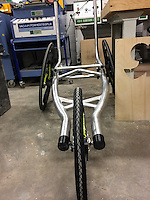 COPY BY TOM BEDFORD<br /> Pictured: The special bicycle used by Poppy Jones for the triathlon while it was being manufactured.<br /> Re: A very special father-and-daughter team have tackled the Cardiff Triathlon on Sunday 26 June 2016.<br /> Poppy Jones, 11, who will be competing alongside dad Rob Jones, wants to win the event.<br /> And she's not going to let the fact that she has quadriplegic cerebral palsy , which means she can't sit, stand, roll or support herself, and chronic lung disease stop her.<br /> She will be by Rob's side every step of the way thanks to a cutting-edge wheelchair and boat – for Rob to push or pull – designed especially for the event, which sees participants take part in a swim across Cardiff Bay , a run and a bike ride.