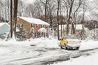 Snow plow clearing street.