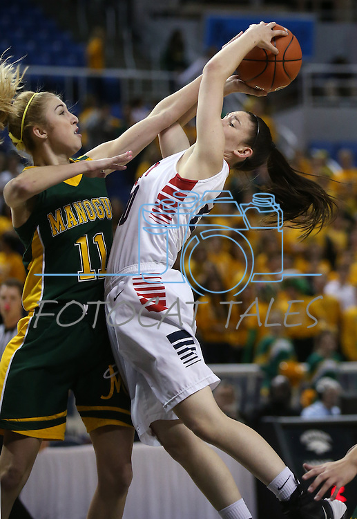 Liberty Patriots' Kealy Brown gets fouled by Manogue defender Brianna Holt in the Division I semi-final game at the NIAA basketball state tournament at Lawlor Events Center, in Reno, Nev., on Thursday, Feb. 27, 2014. Liberty won 43-33. (Cathleen Allison/Las Vegas Review-Journal)