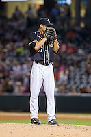 Charlotte Knights relief pitcher Taylor Thompson (27) looks to his catcher for the sign against the Scranton/Wilkes-Barre RailRiders at BB&T Ballpark on July 17, 2014 in Charlotte, North Carolina.  The Knights defeated the RailRiders 9-5.  (Brian Westerholt/Four Seam Images)