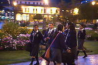YOUNG SCHOOLGIRLS STROLL HOME THROUGH THE STREETS OF CUZCO,PERU