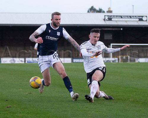 21st November 2020; Somerset Park, Ayr, South Ayrshire, Scotland; Scottish Championship Football, Ayr United versus Dundee FC; Christie Elliott of Dundee is tackled by Patrick Reading of Ayr United