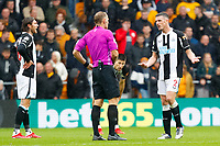 2nd October 2021;  Molineux Stadium, Wolverhampton,  West Midlands, England; EFL Cup football, Wolverhampton Wanderers versus Newcastle United; Ciaran Clark of Newcastle United protests to Referee Graham Scott before he is booked for a foul