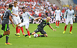 Aaron Ramsey of Wales is tackled by Daniel Sturridge of England in the second half at the Stade Bollaert-Delelis in Lens, France this afternoon during their Euro 2016 Group B fixture.