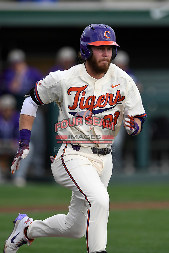 Right fielder Seth Beer (28) of the Clemson Tigers runs out a batted ball in a game against the Furman Paladins on Tuesday, February 20, 2018, at Doug Kingsmore Stadium in Clemson, South Carolina. Clemson won, 12-4. (Tom Priddy/Four Seam Images)