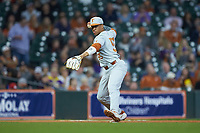 Texas Longhorns third baseman Cam Williams (55) warms up between innings of the game against the LSU Tigers in game three of the 2020 Shriners Hospitals for Children College Classic at Minute Maid Park on February 28, 2020 in Houston, Texas. The Tigers defeated the Longhorns 4-3. (Brian Westerholt/Four Seam Images)