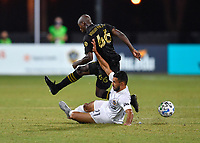 LAKE BUENA VISTA, FL - JULY 18: Bradley Wright-Phillips #66 of LAFC has the ball pushed away by a challenge by Giancarlo González #21 of LA Galaxy during a game between Los Angeles Galaxy and Los Angeles FC at ESPN Wide World of Sports on July 18, 2020 in Lake Buena Vista, Florida.