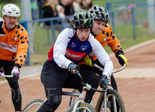 19 APR 2015 - IPSWICH, GBR - Lewis Roberts (centre) of Ipswich Eagles fights to hold his line into a corner whilst under challenge from Andy Angell (right) of Sheffield Stars during the two teams Elite League cycle speedway fixture at Whitton Sports and Community Centre in Ipswich, Suffolk, Great Britain (PHOTO COPYRIGHT © 2015 NIGEL FARROW, ALL RIGHTS RESERVED)