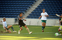 FC Gold Pride forward Marta (10) scores the game's first goal on a shot in front of Red Stars defender Natalie Spilger (13).  The FC Gold Pride defeated the Chicago Red Stars 3-2 at Toyota Park in Bridgeview, IL on August 22, 2010