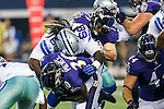 Dallas Cowboys tackle Doug Free (68) and Baltimore Ravens running back Bernard Pierce (30) in action during the pre-season game between the Baltimore Ravens and the Dallas Cowboys at the AT & T stadium in Arlington, Texas. The Ravens lead Dallas 24 to 10 at half time.
