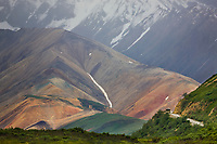 Tour bus travels the Denali Park road on Polychrome pass, Denali National Park, Interior, Alaska.