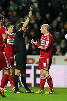 Wednesday, 12 December 2012<br /> Pictured: Nicky Bailey of Middlesbrough (R) sees a yellow card by match refere Lee Probert (L)<br /> Re: Capital One Cup, fifth round, Swansea City FC v Middlesbrough at the Liberty Stadium, south Wales.