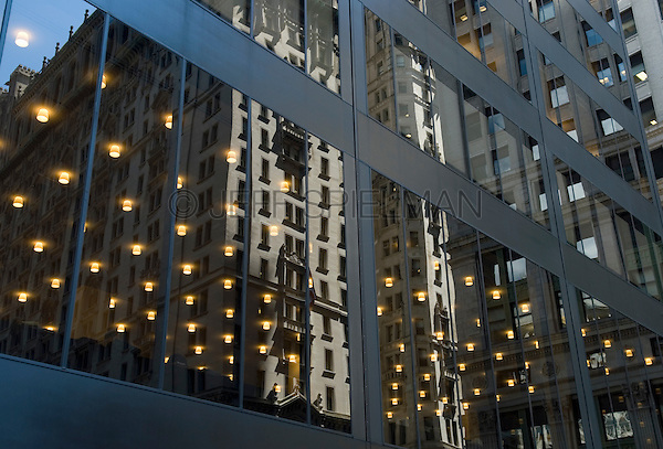 AVAILABLE FROM JEFF FOR EDITORIAL LICENSING.<br /> <br /> Office Building Windows and Reflections on Broadway in Lower Manhattan's Financial District, New York City, New York State, USA
