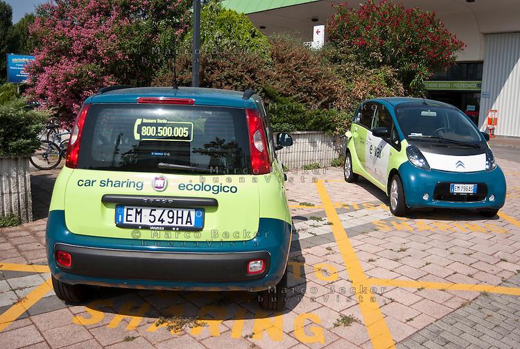 """Milano, postazione car sharing """"e-vai"""" alla stazione ferroviaria del quartiere Bovisa --- Milan, """"e vai"""" car sharing at the railway station in Bovisa district"""