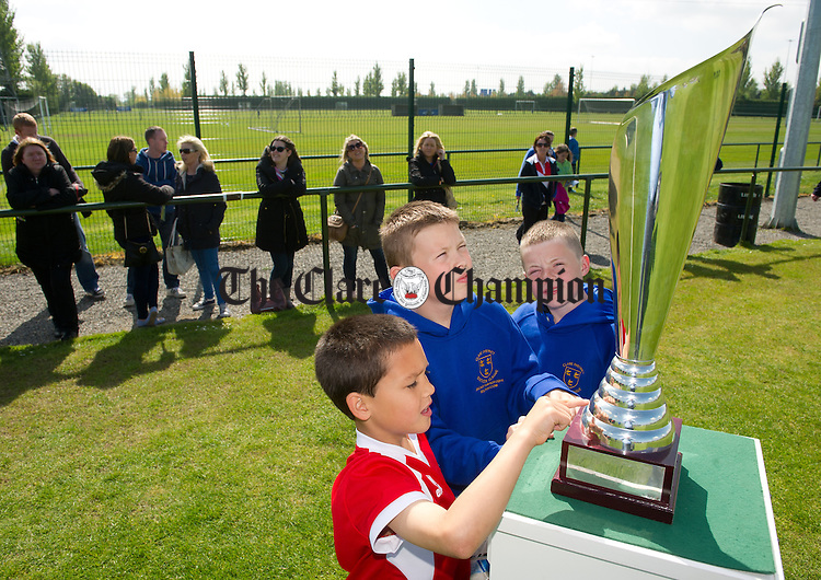 Young Clare fans Cathal Cullinan, Dylan Cusack and Lee Cregan of Newmarket admire the silverware on offer before the Oscar Traynor Trophy Final against AUL Dublin at AUL Complex, Clonshaugh, Dublin. Photograph by John Kelly.