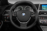 Steering wheel view of a 2010 BMW 6 Series 640i Convertible