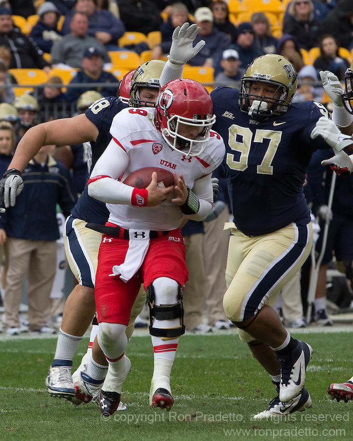 Chas Alecxih and Aaron Donald (97) sack Utah quarterback Jon Hays.The Utah Utes defeated the Pitt Panthers 26-14 at Heinz Field, Pittsburgh, Pennsylvania on October 15, 2011.