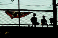 Two young fans watch the action from the top row of the stands behind home plate during the Appalachian League game between the Bristol White Sox and the Burlington Royals at Burlington Athletic Park on July 10, 2011 in Burlington, North Carolina.  The White Sox defeated the Royals 4-3.   (Brian Westerholt / Four Seam Images)